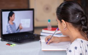 concept of homeschooling or e-learning young girl